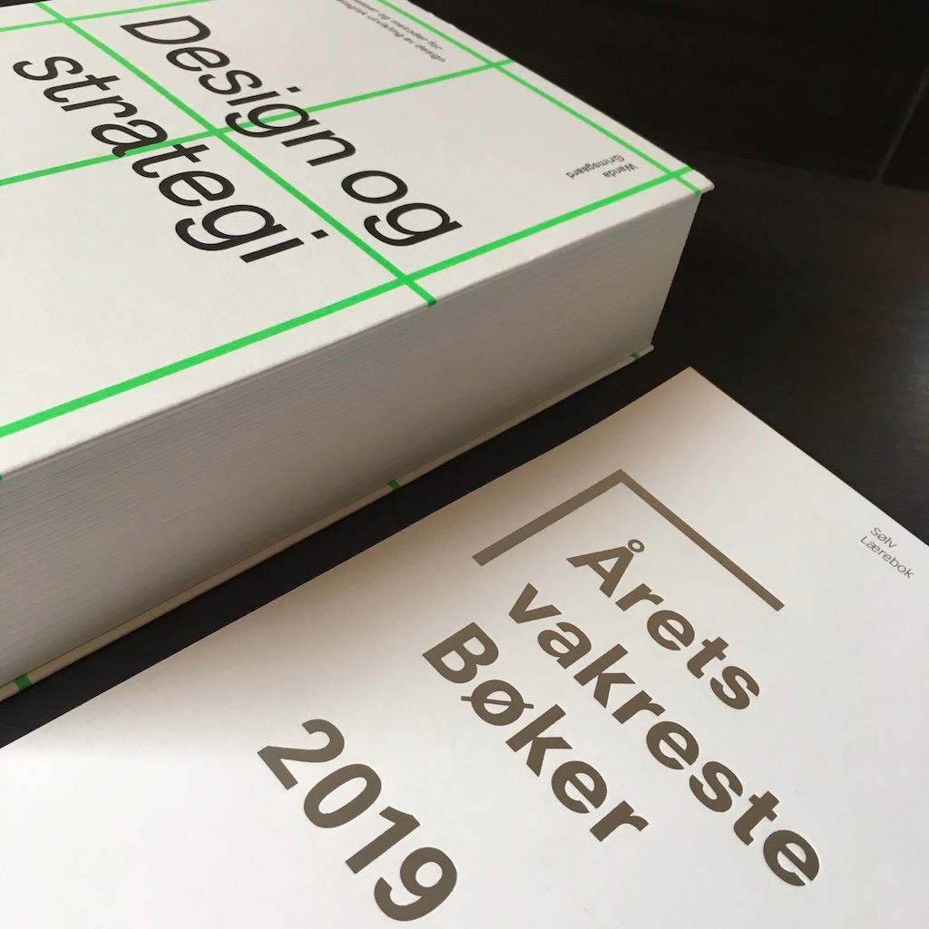 """Design og strategi"" [Design and Strategy] won silver medal in the Most Beautiful Norwegian Books competitition ""Årets Vakreste Bøker 2019""."